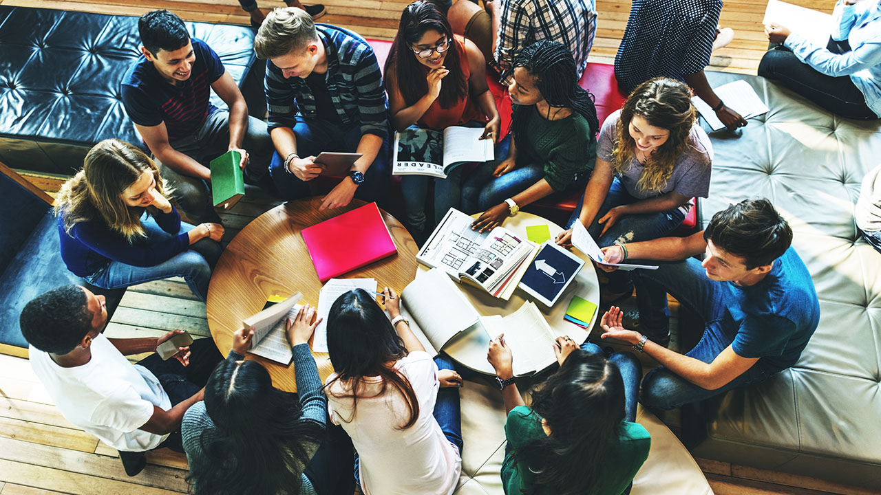 Overhead shot of students studying together at a round table