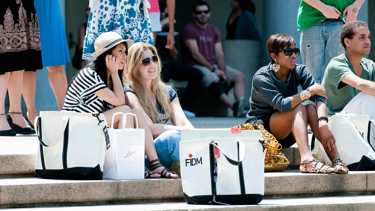 Students take a break on the steps of Hope Park in front of FIDM Los Angeles