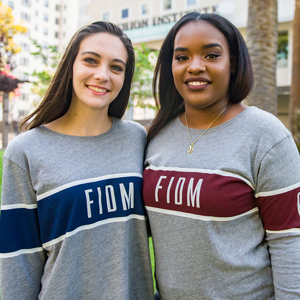 Two students wearing FIDM sweatshirts