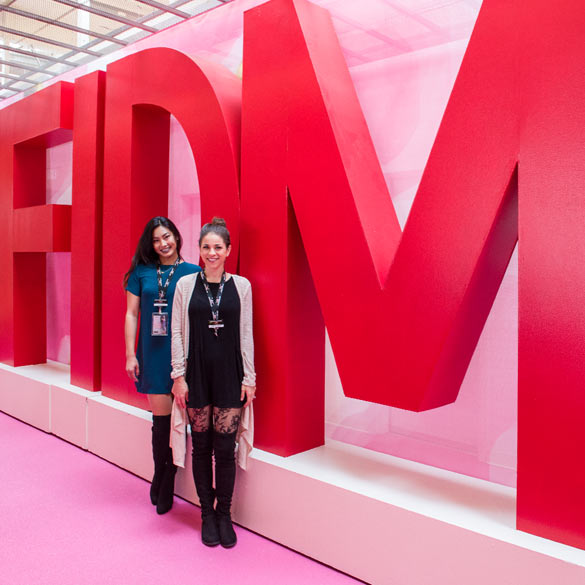 Ladies posing in front of FIDM sign