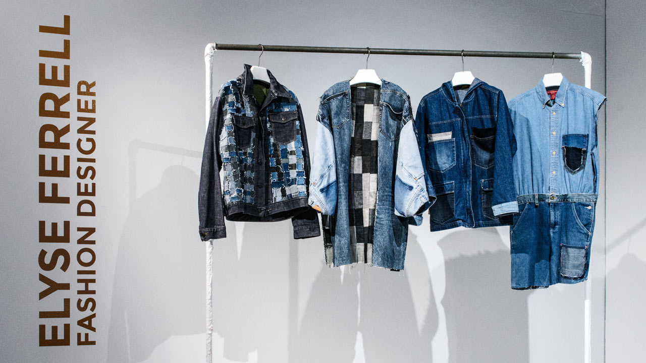 Blue articles of clothing hanging on rack