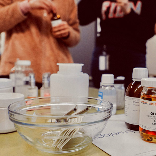 Students mixing perfume samples