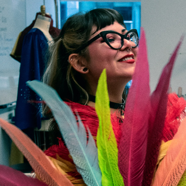 fashion design student working with colorful feathers