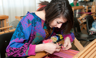 Student working in the Textile Design Weaving Lab on FIDMs LA Campus.
