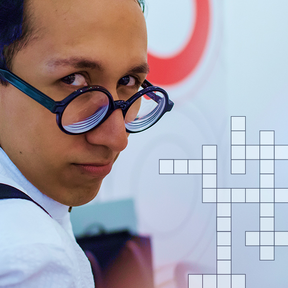 Student with glasses with a crossword puzzle overlay