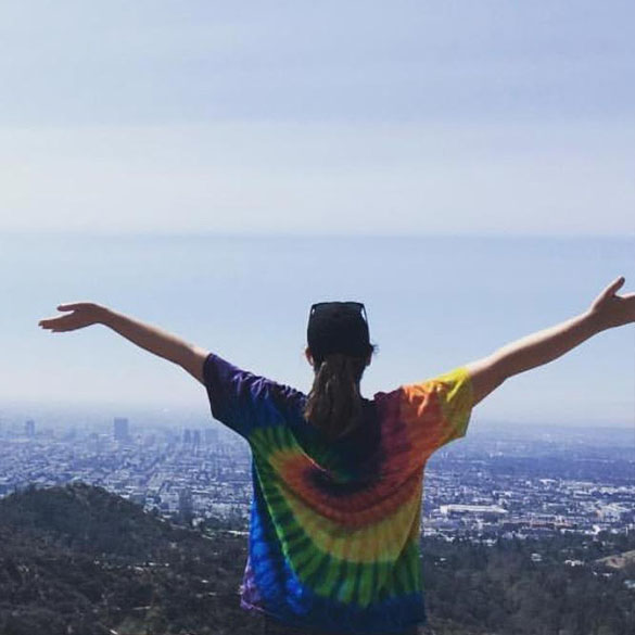 Student in a tie dye shirt enjoys the view from Griffith Park